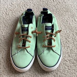 Mint green slip on Sperry shoes.